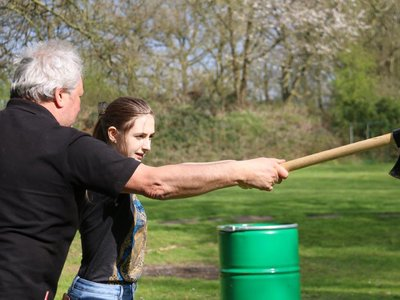 Teaching-the-Girl-How-Throwing-Axe-Works..jpg